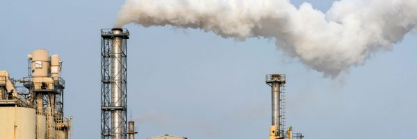 Smoke from the factory pipes. Ecological problem